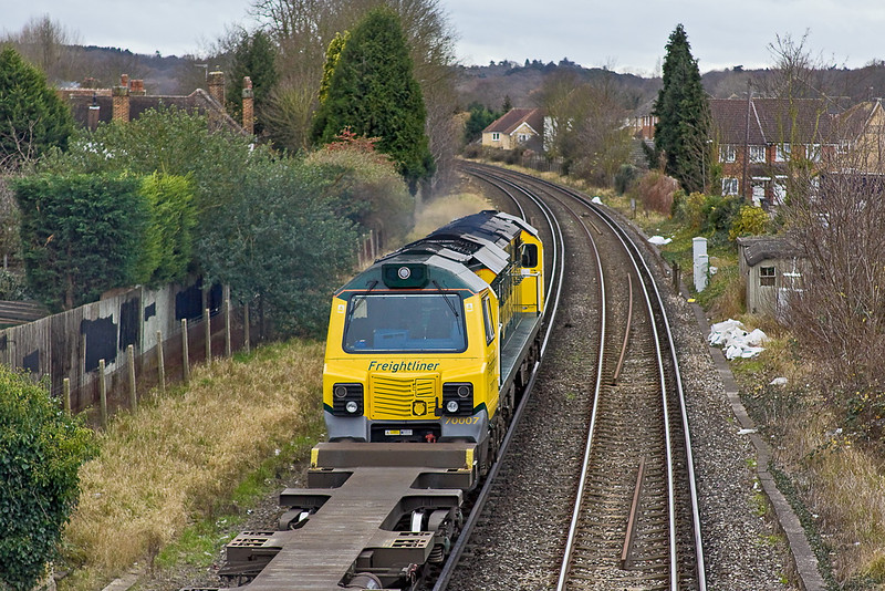 29th Dec 11:  Due to line closure between Didcot and Oxford  4O27 from Trafford Park to Southampton was diverted via Staines.  With 70007 on the front who could resist the opportunity for a picture despite the poor weather.  A Juniper snookered the approach shot unfortunately