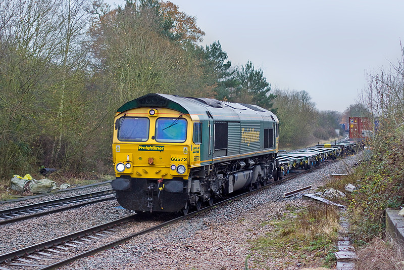 19th Dec 11:  4M28 from Southampton to Ditton is powered by 66572 on a cold, dull and drizzly day.  Pictured from the site of the End Loading Dock at Mortimer Station