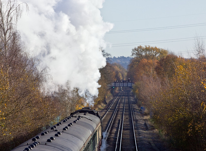 10th Dec 11:  The photographers on the foot bridge on Addlestone Moor in Chertsey raise their lenses as Britannia accelerates towards them after a water stop at Chertsey