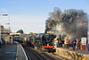 10th Dec 11:  During it's water stop at Chertsey BR Standard Pacific 70000 throws out some smoke at the fireman puts on a few more shovels of coal.  The Cathex is working from Southend to Winchester