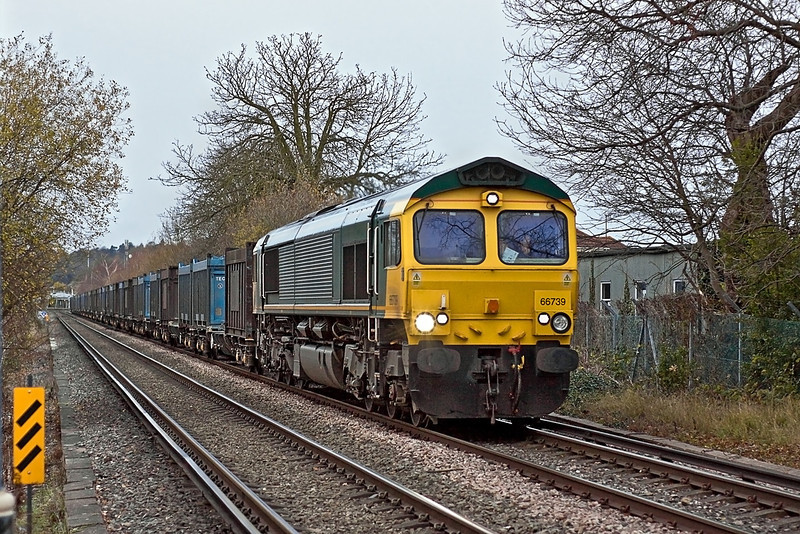 14th Dec 11:  The Mountfield to Southampton empty Gypsum containers crosses Addlestone Moor with 66739 at the helm