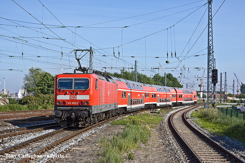 2nd Jun 11:  143 852-2 leaves Varnemunde with the 17.38 shuttle to Rostock.  The journey takes nearly 20 minutes and costs about £1.70.  Trains run every 15 minutes each way