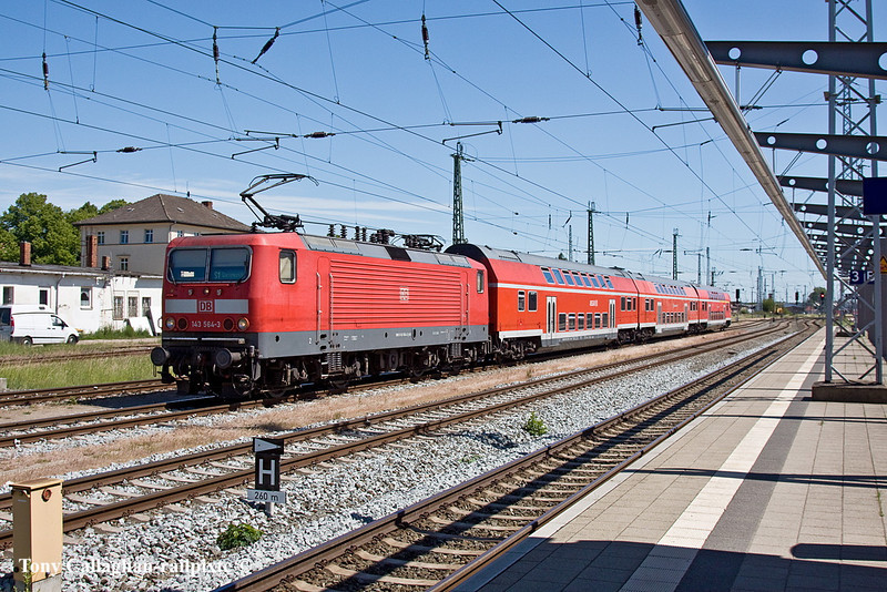 4th Jun 11:  With a through service taking it's slot on the Rostock to Warnemunde shuttle 143 504-3 and it's 3 car set waits in a loop out of the way