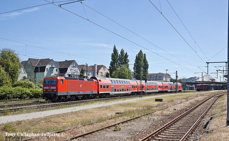 4th Jun 11:  Leaving from Platform 2 143 250 works a Rostock to Warnemunde shuttle