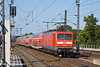 10th Jun 11:   A 5 coach interegional train pushed by 112 183 leaves westwards from platform 9 at Berlin HBf