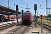 4th Jun 11:  A filthy 101 044-6 pushes hard as an express from Hamburgh leaves Rostock