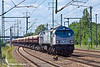 10th Jun 11:    ITL's 250 006-6 powers a very long rake of loaded side tippers through Schonefeld