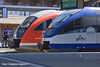 4th Jun 11:  A pair ot 2 car DMUs at Rostock.  642 683 will return to Graal Muritz and OLA 0001 to Gustrow.