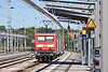 v 114 012-8 departs from platform 6 at Rostock with a through service to Warnemunde