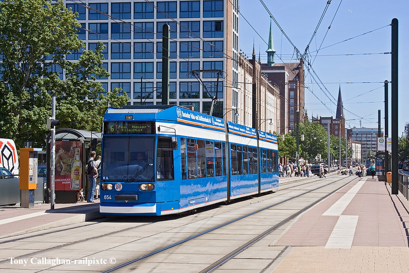 3rd Jun 11:  Without advertising graphics Tram 654 picks up in Lange Strasse
