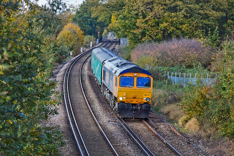 1st Nov 11:  66717 trundles through Lyne bringing 2 barrier coaches back to Eastleigh.  5Z66 started from Peterborough