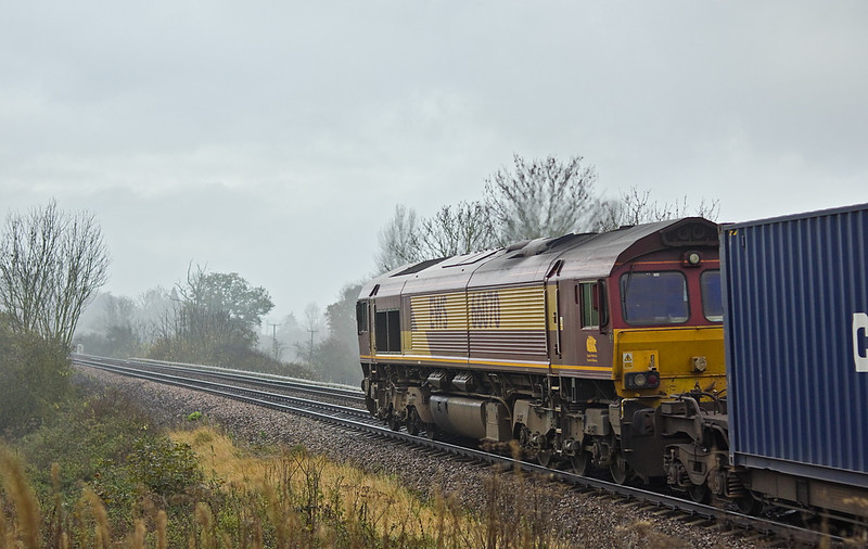 17th Nov 11:  66070 on the point of 4O53 from Wakefield Europort to Southampton passes Grear Park Crossing near Mortimer on a very crud morning
