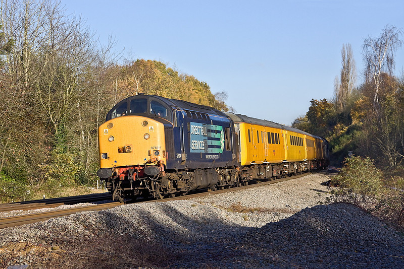 30th Nov 11:  Taking the line to Basingstoke at Southcote Junction is 37604 Top 'n Tailed by 37038.  1Q13, a Network Rail test train, is woking the Reading to Basingstoke leg of the day's itinery.  It had earlier worked to Reading via the Berks & Hants line and would return that way after the sojourn to Basingstoke and back.
