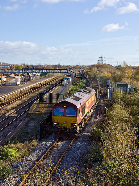 27th Nov 11:  66093 has  waited for the next section to clear and now leaves Severn Tunnel Junction with 6W42 empty rail carriers from Lydney to Westbury.  It will run round and come back and go via the Severn Tunnel