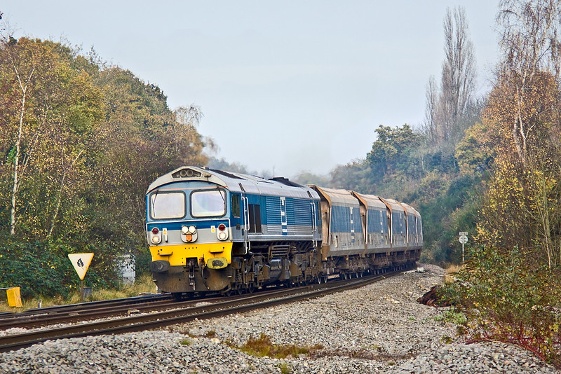 21st Nov 11:  59004 takes the West of England line at Southcote Junction in Reading with 7C77 from Acton to Merehead