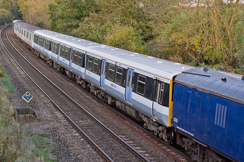 9th Nov 11:  508204 in newer South Eastern livery and a very scruffy 508207 also in SE livery are being taken from Donnington to Eastleigh behind 66731.  Seen here at Silchester