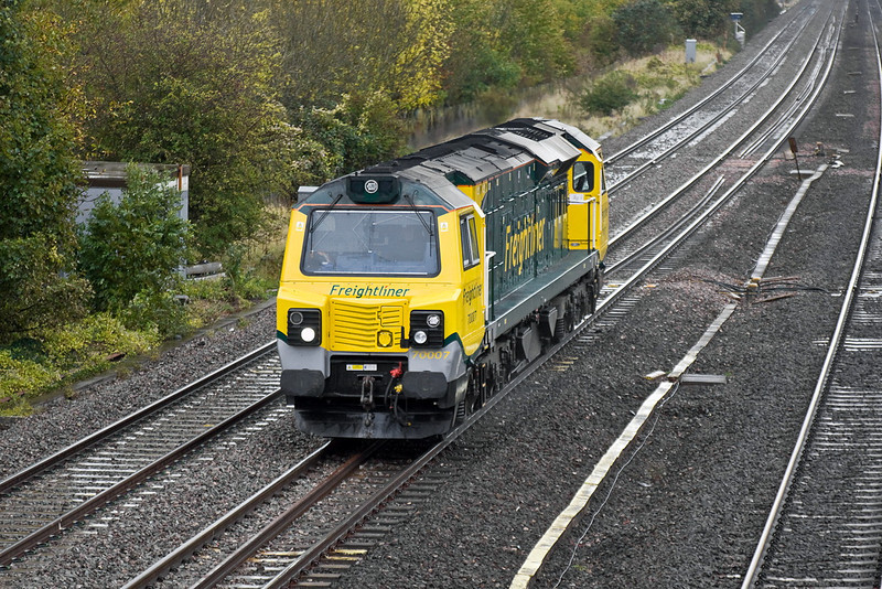 19th Oct 11:  Just after  a heavy shower 70007 rushes north through Lower Basildon to rescue 66518 which had failed at Banbury while working 4O54 from Leeds.  Unusually for a loco only move it was given the reporting number of 1Z99