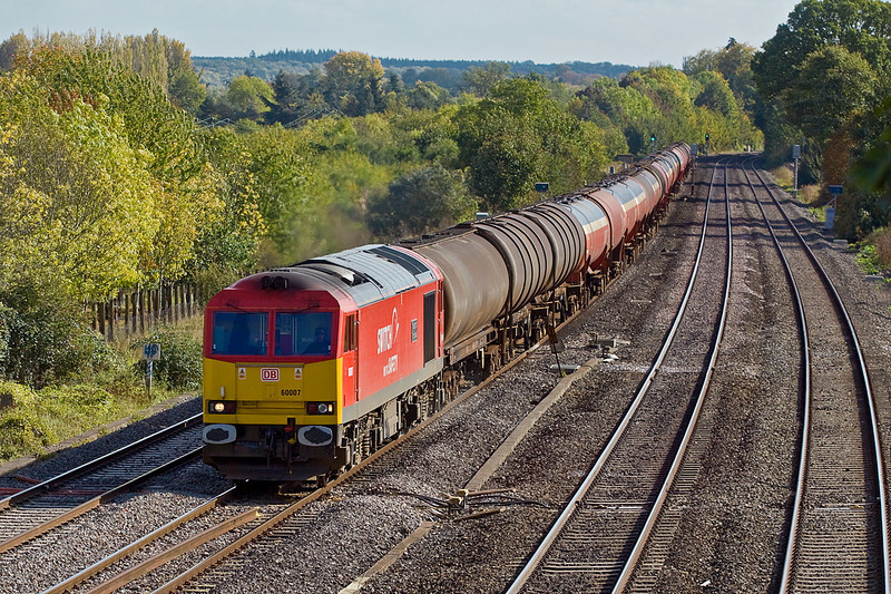 6th Oct 11:  60007 catches the light as it brings the empty Murco oil tanks through Lower Basildon.  The destination of 6B33 is Robeston in South Wales