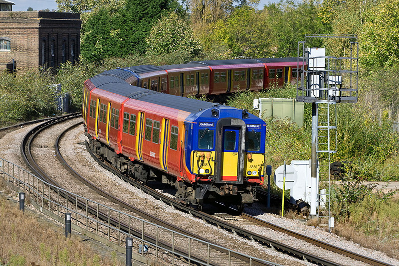 20th Oct 11:  455858 rounds the tight curve into Guildford with the 13.09 from Waterloo via Epsom