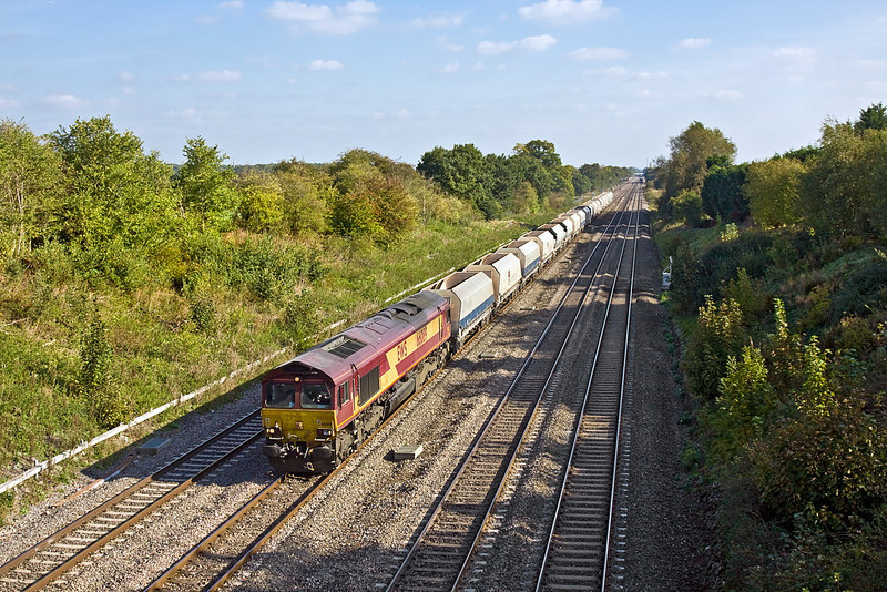 14th Oct 11:  The Hayes to Moreton on Lugg empties powered by 66089 is seen from the Southbury Lane bridge in Ruscombe.