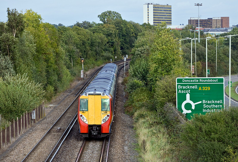 9th Oct 11:  458018 heading west away from Bracknell with the 15.09 from Waterloo to Reading.  Now running 16 minutes late as engineering work had forced a diversion via Wimbledon, Kingston and a reversal at Twickenham.
