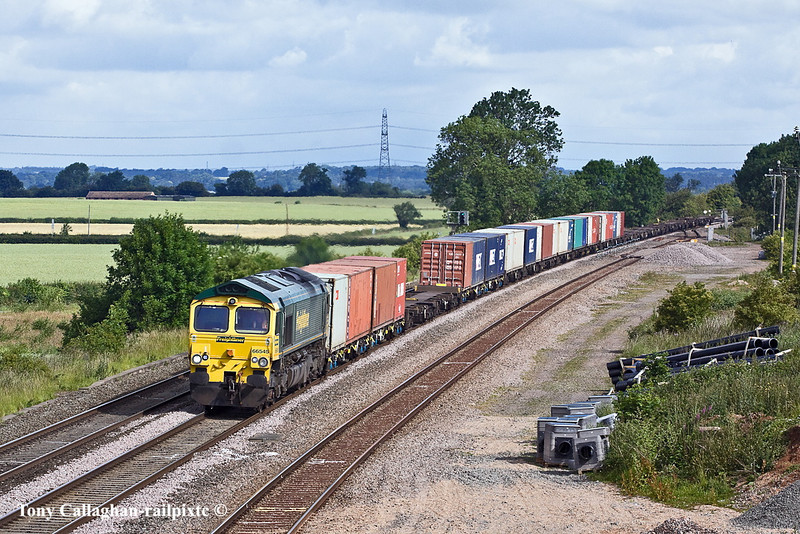 30th Jun 11:  Racing south past the loop at Elford is the Green Team's 66545 hauling 4O54 from Leeds to Southampton