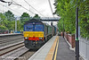 30th Jun 11:  Ex Fastline 66302 heads south through Atherstone in charge of 4M34 from Coatbridge to Daventry