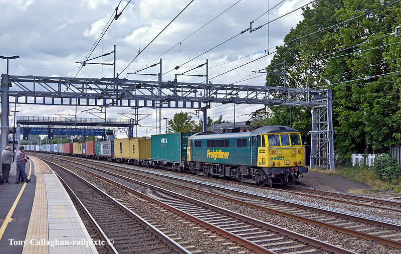 30th Jun 11:  In the worst light of the day 86501 heads south though Rugeley with 4L92 from Ditton to Felixstowe