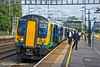 30th Jun 11:  Passenger alight from London Midland's 350130 at Rugeley. 1N41 is the 15.46 Euston to Crewe