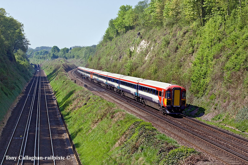 23rd Apr 11:  Gatwick Express units 442408 & 419 are forming the 10.19 from Brighton to Victoria.  1A83 is pictured fron the Wood Down Road bridge in Coulsdon