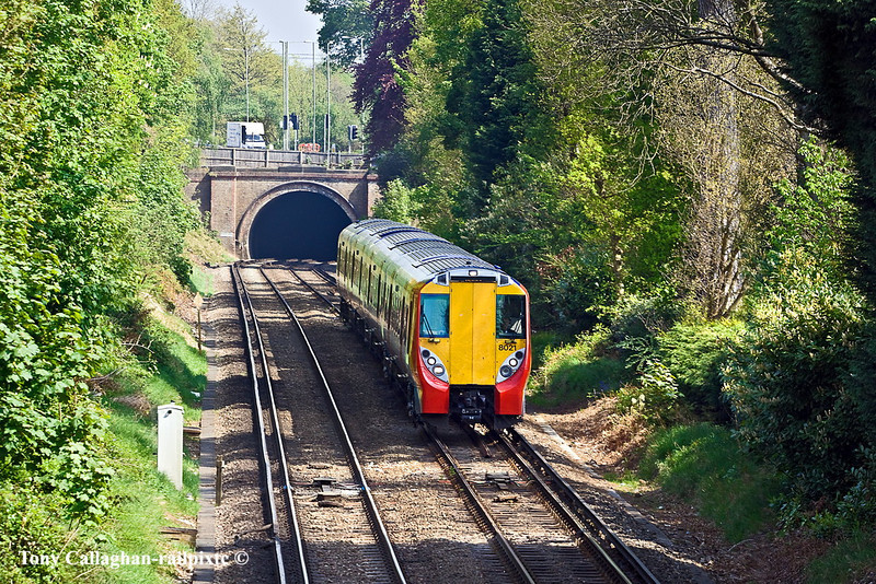 21st Apr 11:  458021 has just passed under the short tunnel under the A30 near Camberley.  458021 is working 2N29 the 12.23 from Ascot to Guildford