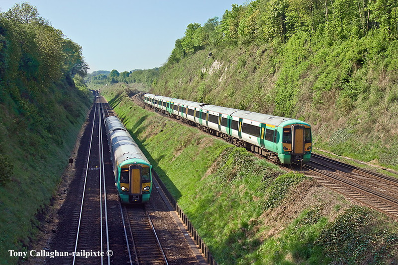 23rd Apr 11:  From the Wood Down Road bridge in Coulsdon are pictured 377119 on the 10.21 Victoria to Brighton (1A78) passing 377452 and the 10.00 from Horsham to London Bridge