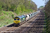 9th Apr 11:  On a beautiful Saturday morning 66597 trundles west through the Sonning Cuttinf while working 6V87 from Crawley to Stoke Gifford