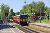 27th Apr 11:  The 13.41 from Shepperton to Waterloo ia crossing the level crossing in Percy Road  at Hampton