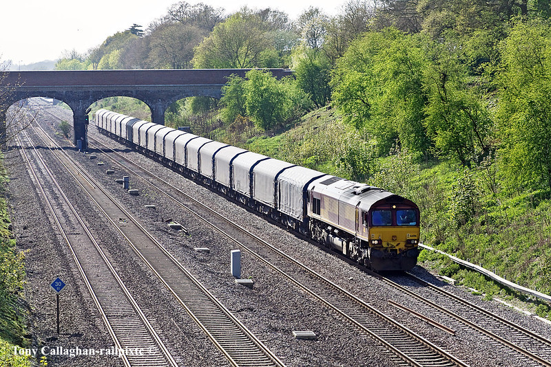 10th Apr 11:  The Llanwern to Dollands Moor covered steel carriers trundles east through Ruscombe.  6Z14 is being worked by 66016