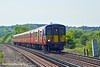 24th Apr 11:  2S37 the 12.03, formed of 455917, from Weybridge to Waterloo nears Prune Hill level crossing near Egham