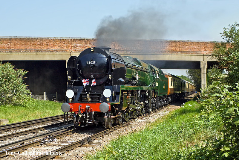 30th Apr 11:  On the day after the Royal Wedding 35028 Clan line is captured passing under the A308 near Staines.  1Z84 is the VSOE 'Surrey Hills Luncheon Excursion@