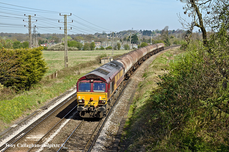 11th Apr 11:  Running through Badshot Lea near Farnham is 66111 working 6E32 from Fawley to Holybourne
