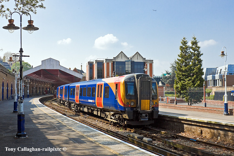 17th Apr 11:   Waiting to depart from Windsor & Eton Riverside is the 12.01 all stations to Waterloo. 450558 forms 2U34