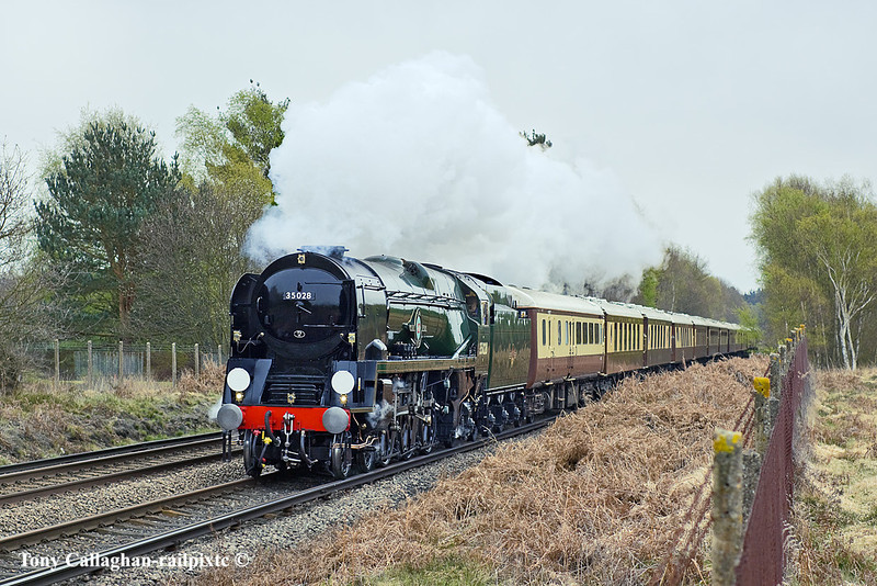 13th Apr 11:  Charging across Chobham Common as it nears Sunningdale is 35028 working the day's VSOE from Victoria to Bristol