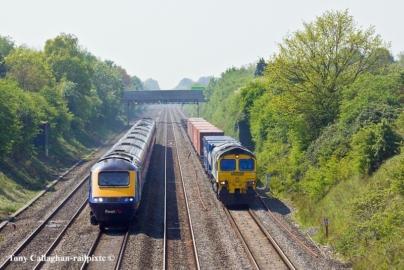 20th Apr 11:  The Bristol to Tilbury wine liner, 4L32, hauled by 66503 is rapidly overtaken by the 11.55 from Cardiff as they near Breadcroft Lane in Maidenhead
