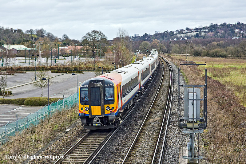 6th Feb 11:  The 11.41 from Haslemere to Waterloo formed of 444025+032 nears Shalford Junction.  The Park & Ride can be seen on the left.