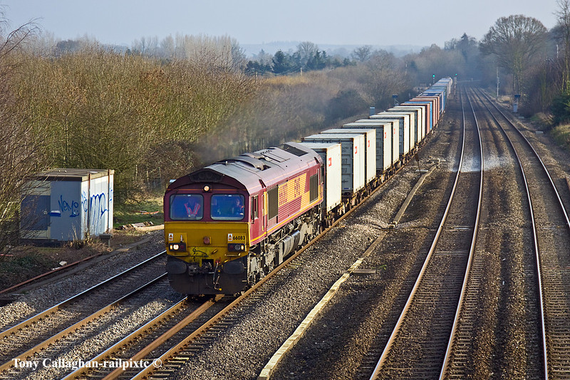 17th Feb 11:  With a very long rake in tow 66083 plies 6V38, the MoD service from Marchwood to Didcot, through Lower Basildon