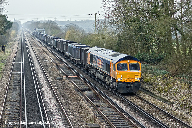 "21st Feb 11:  Pictured from the Ashmoor Lane bridge in Old Basing is 66715 ""Valour"" hauling 4Y19 the gypsum empties from Mountfield to Southampton"