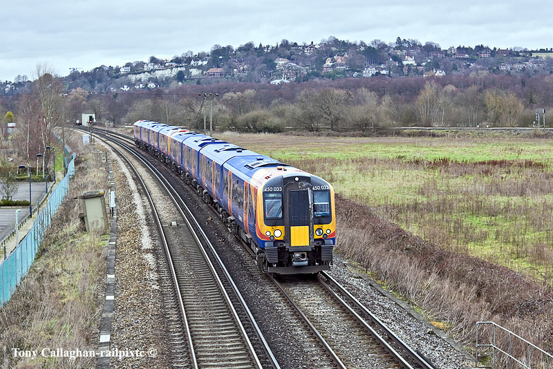 6th Feb 11:  450033 & 450121 head south away from Shalford Junction as they work 2P25 the 11.00 from Waterloo to Haslemere.  The line to Redhill can be seen across the field.
