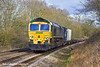 16th Feb 11:  Rushing south over Great Park Crossing  near Mortimer is 66538 in charge of 4O54 from Leeds