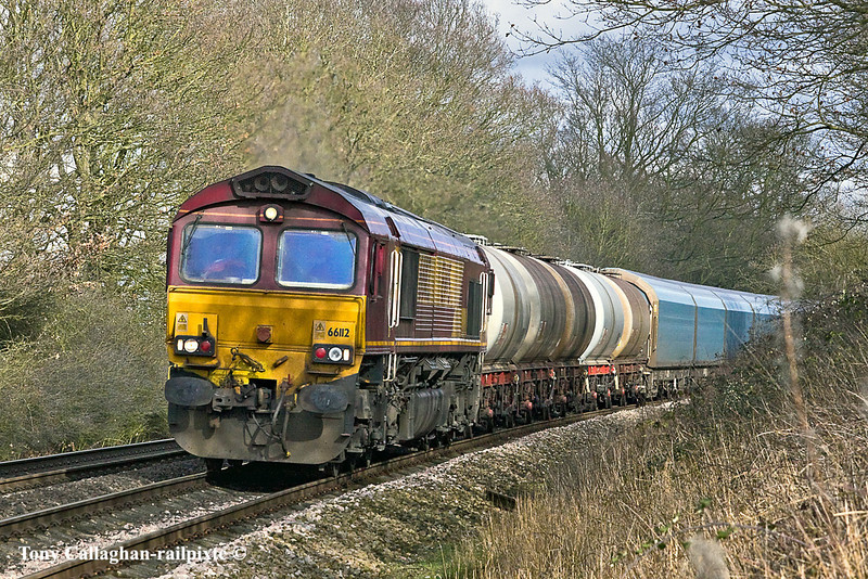 16th Feb 11:  In dappled shade 66112 hauls 6O15 the 11.27 from Didcot to Eastleigh.  Captured at Great Park Crossing