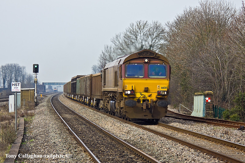 17th Feb 11:  Running earlier that expected is 66130 and 6Z52,  mud empties, from Appleford to Bow Olympic. Note the still extended Buck Eye coupling.   Pictured at Cholsey