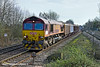 24th Feb 11:  Heading west through Tilehurst is Euroshed 66033 working 6V39 from Ludgershall to Didcot