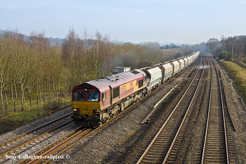 17th Feb 11:  Taking empty EWS branded hoppers  back to Moreton on Lugg from Hayes is 66024.  The working is 6B35